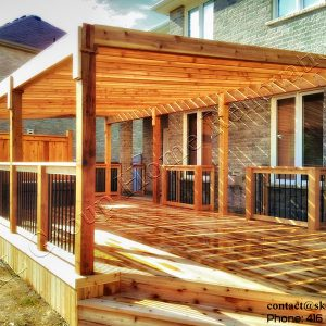 Cedar deck with pergola, aluminum railing and a privacy fence