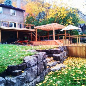 Image of Three level cedar deck over a ravine with hut tab and pergola in Toronto Ontario, designed and built by SKLGroup