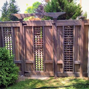 Pre stained cedar wood fence and a gate in Toronto Ontario