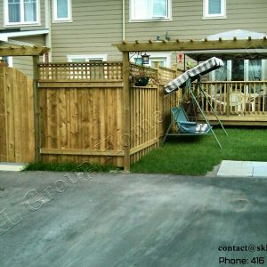 Pressure treated wood fence in Markham Ontario, built by SKL Group.